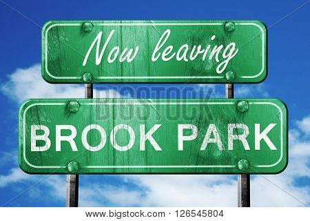 Now leaving brook park road sign with blue sky