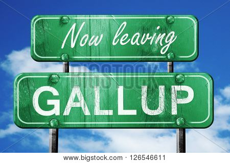 Now leaving gallup road sign with blue sky