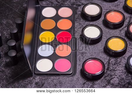 Makeup Brushes And Eyeshadow Palette In Beige And Orange Tones, Cosmetics Close-up