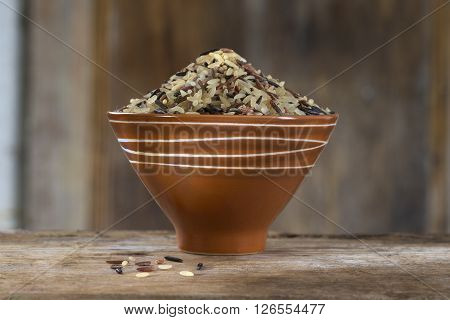 Long grain and wild rice mix in brown bowl