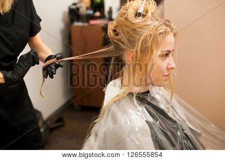Hair Stylist At Work - Hairdresser  Applying A Color On   Customers  Hair After Haircut And Before D