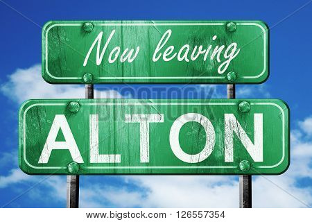 Now leaving alton road sign with blue sky