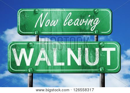 Now leaving walnut road sign with blue sky