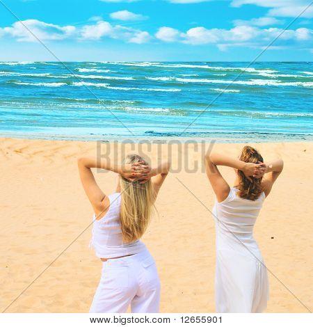 "two women enjoying sea view - see more of  ""Beach"" series in portfolio"
