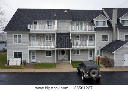 HARBOR SPRINGS, MICHIGAN / UNITED STATES -DECEMBER 23, 2015: A condominium building near the Zorn Park Beach in Harbor Springs
