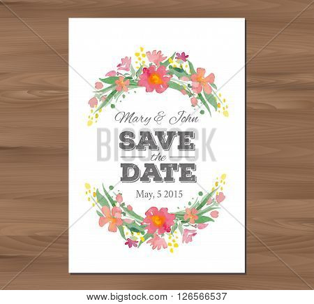 Save the date wedding invitation with watercolor flowers and typographic elements. Card template on a wooden background. Free fonts used - Nexa Rust, Alex Brush, Crimson