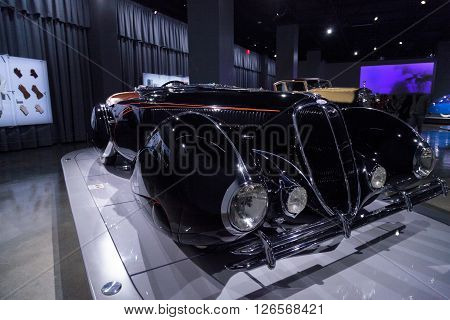 Los Angeles, CA, USA -- April 16, 2016: This black and orange 1938 Delahaye Type 135M Competition Roadster by Figoni et Falaschi on display at the Petersen Automotive Museum in Los Angeles, California, United States. While ten were originally built, it is