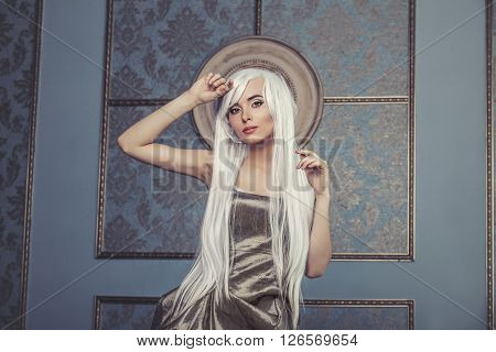 Beautiful Woman Model With Long Platinum White Hair In The Background Of The Interior