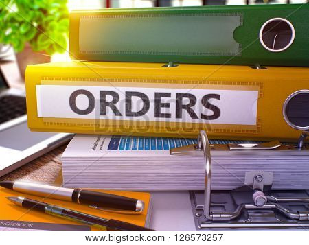 Orders - Yellow Ring Binder on Office Desktop with Office Supplies and Modern Laptop. Orders Business Concept on Blurred Background. Orders - Toned Illustration. 3D Render.