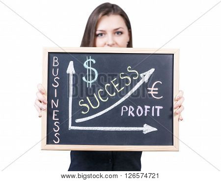 Young woman holds business graph on a blackboard