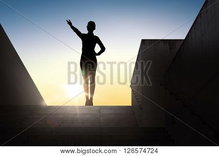 business, success, achievement and people concept - silhouette of woman pointing hand and showing direction standing on stairs over sun light background