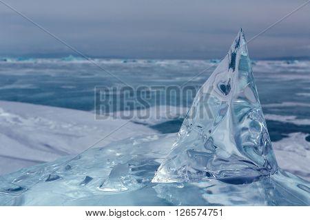 Beautiful transparent block of ice. Winter landscape in the Lake Baikal.