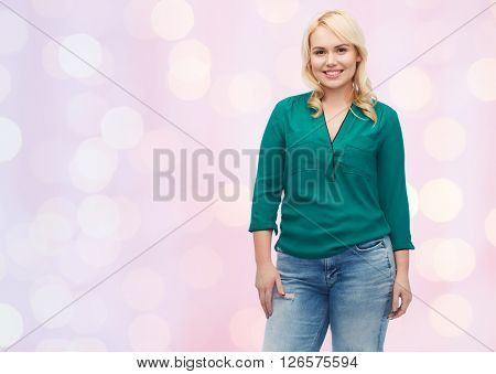 female, gender, portrait, plus size and people concept - smiling young woman in shirt and jeans over pink holidays lights background
