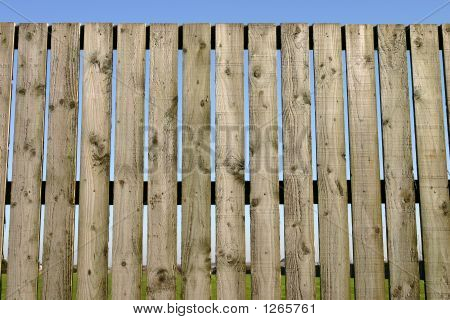 Close Up Of A Wooden Perimeter Fence.