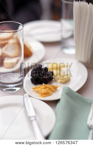 Appetizers and bread platter at restaurant