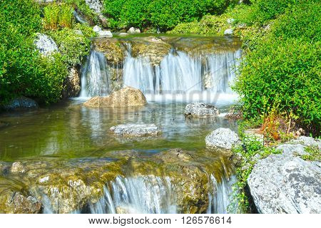 Waterfall in beautiful landscape long exposure for blurred water