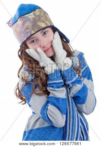 Pretty teen girl in winter clothes getting warm  on white background
