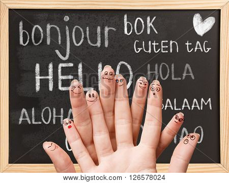 Hello in various languages on a black chalkboard