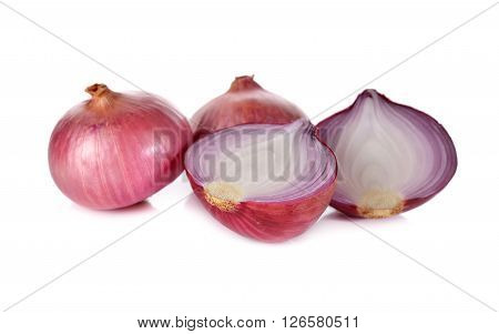 whole and half cut red onion shallots on white background ** Note: Shallow depth of field