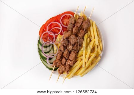 Fresh kebab meat with french fries on white background