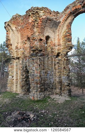 Ruined walls with arch remains of the burned chapel