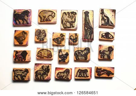 Aligned wooden childrens rubber stamps with animals
