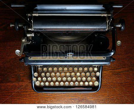 Old black mechanical typewriter top part with full keyboard