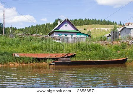 wooden boats on the riverside in a summer sunny day