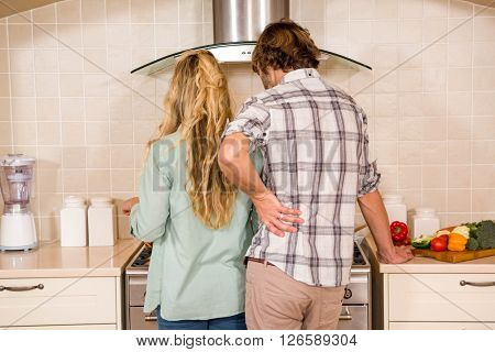Cute couple cooking together in the kitchen