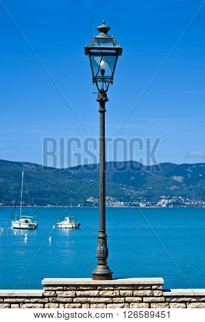 lamppost with light bulb on the waterfront