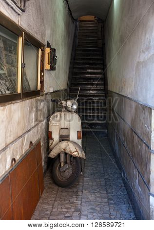 View of Vintage Italian scooter parked inside the doorway