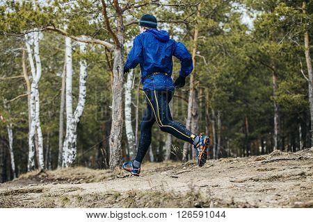 Chelyabinsk Russia - April 3 2016: young male athlete marathon runner running race in forest during Spring half marathon