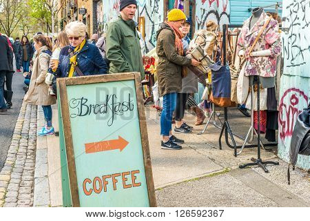 London United Kingdom - April 17 2016: Columbia Road Flower Sunday market. Side streets of the market with vintage clothing food and drinks on sale