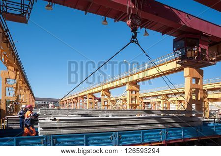 Tyumen, Russia - August 13, 2013: Finished goods warehouse at Concrete Goods Plant No. 5. Loading concrete products in onboard car
