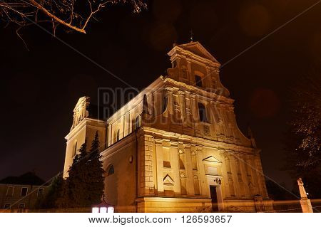 Night view of the baroque facade of the church in Poznan