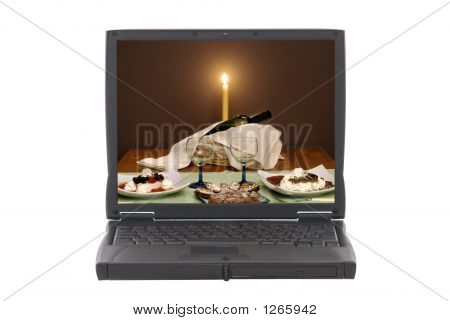 Laptop With Romantic Dinner Invitation On Screen
