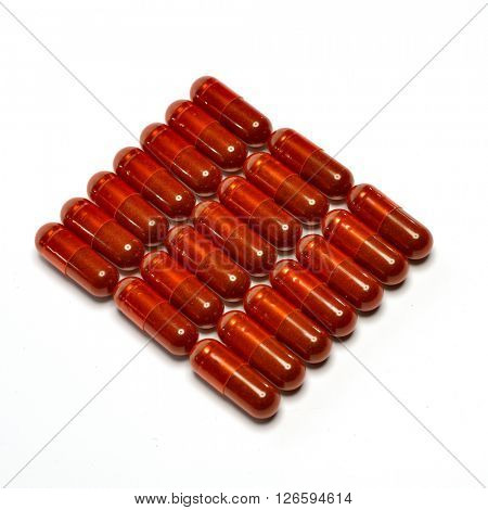 red pills isolated on white background