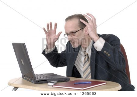 Dissapointed Businessman Working On Laptop