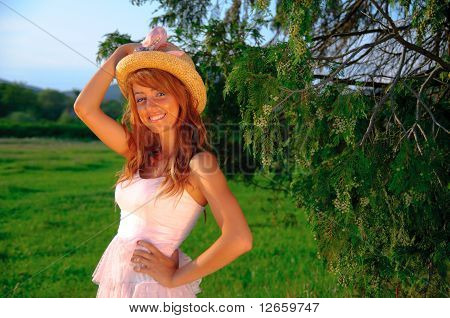 Sexy Young Girl Smiling On Sunset Green Background