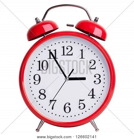 Round red alarm clock shows five minutes to three