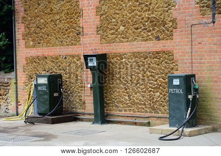Vintage green Petrol and Diesel pumps in forecourt