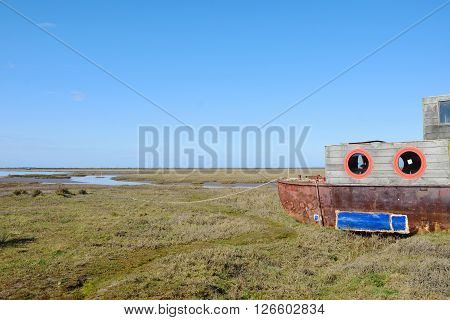 Wooden Houseboat in tidal estuary norfolk uk