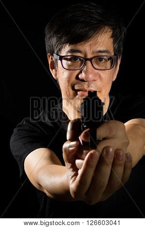 Asian Chinese Man Holding A Gun