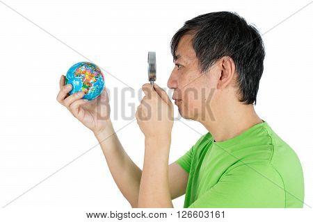 Asian Chinese Man Looking At Globe Through Magnifying Glass