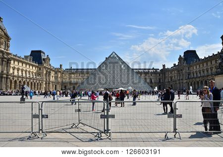 Paris France - May 13 2015: Tourist visit Louvre museum on May 13 2015 in Paris. This is one of the most popular tourist destinations in France.