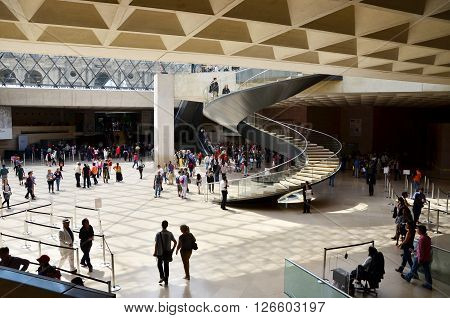Paris France - May 13 2015: Tourists visit Interior of Louvre museum on May 13 2015 in Paris. Louvre is one of the biggest Museum in the world receiving more than 8 million visitors each year.