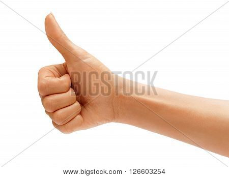 Women's hand with thumb up isolated on white background positive concept. High resolution product. Close up