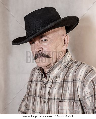 The cowboy with mustache in a black hat