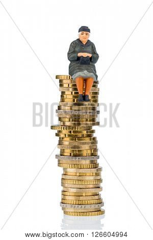pensioner sitting on money stack