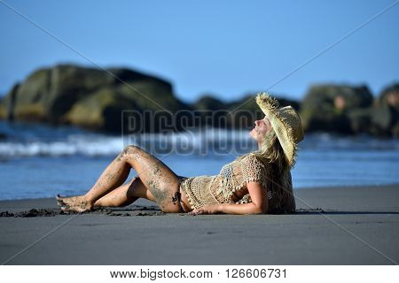 young happy woman on the beach in summer vacation